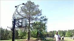 Longest Basketball Shot Made While Trampolining