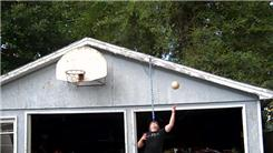 Most Consecutive Basketball Shots Made Into A Hoop Balanced On One's Own Head