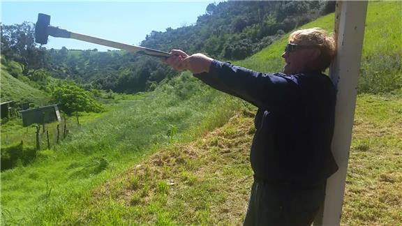 Two-Handed Hold of a 14 Pound Sledge Hammer, Arms Held Straight, Parallel to Ground