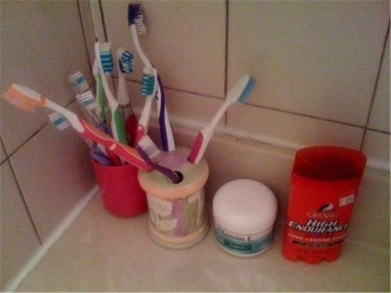 Most Toothbrushes On Bathroom Counter