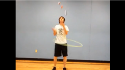 Most Balls Juggled While Hula Hooping