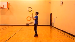 Longest Time To Juggle Three Rings While Hula Hooping