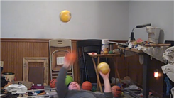 Most Catches Juggling Three Five-Pound Balls While Lying Down