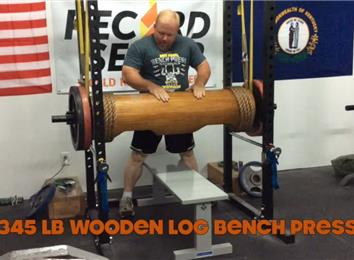 Most Reps Bench Pressing A 345-Pound Wooden Log