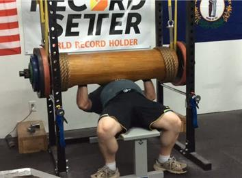 Most Reps Bench Pressing A 405-Pound Wooden Log