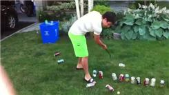 Most Empty Soda Cans Hit While Swinging A Golf Club With One Hand In Five Seconds