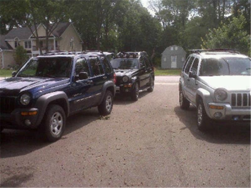 Most Jeep Libertys Parked In A Driveway