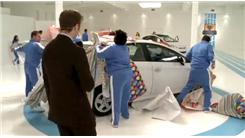 Fastest Time  To Unwrap A Toyota Prius Wrapped In Gift Wrap And Bow