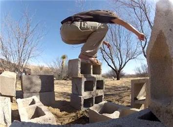 Tallest Cinder Block Tower Stacked With Feet While Standing On Stack
