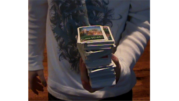 Most Playing Cards Held In Hand At Once