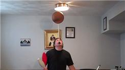 Most Catches With Four Clubs While Spinning A Basketball On A Mouthstick Held In Mouth