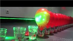 Most Balloons Popped Domino-Style With A Laser
