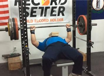 Most Reps Two-Board Bench Pressing A 425-Pound Barbell