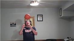 Longest Time To Spin A Mini Basketball On A Mouthstick Held In Mouth
