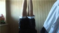 Longest Headstand While Wearing Mismatched Socks
