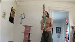 Tallest Soda Can Tower Balanced On Right Middle Finger