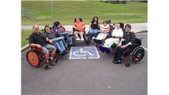 Largest Group Of People In Wheelchairs In A Disabled Parking Space At Once
