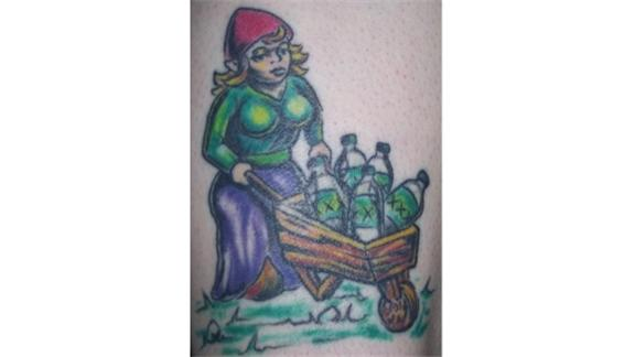 Most Bottles In A Tattoo Of A Gnome Pushing A Wheelbarrow Of Bottles