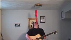 Longest Time To Balance Juggling Club On Chin While Singing And Playing Guitar