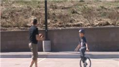 Most Consecutive Football Catches While Riding A Unicycle
