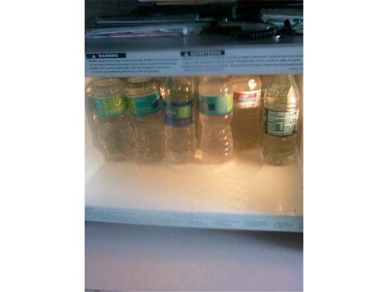 Most 1/2 Liter Water Bottles Fit Inside A Microwave Oven