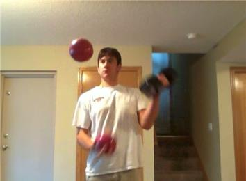 Most 25-Pound Dumbbell Curls While Juggling Two Four-Pound Balls