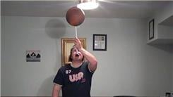 Longest Time To Spin A Pillow On Each Finger While Spinning A Basketball On A Mouthstick Held In Mouth