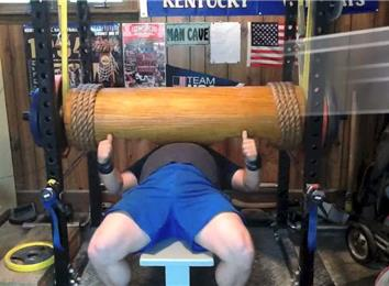 Most Reps Bench Pressing A 395-Pound Wooden Log