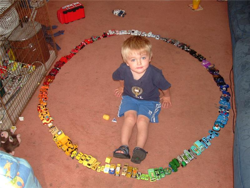 Largest Toy Car Circle Built Around A 3-Year Old