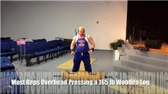 Most Overhead Presses Using A 165-Pound Wooden Log