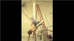 Longest One-Armed Handstand While Assistant Spins Around With A Balancing Ball On Face