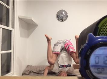 longest headstand on a bed  world record  saxon thomas