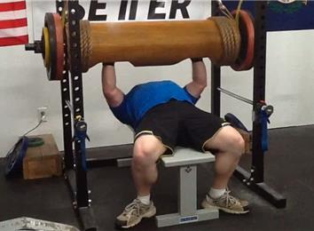 Most Reps Bench Pressing A 370-Pound Wooden Log