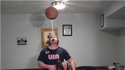 Most Consecutive Catches Juggling Three Basketballs While Spinning A Basketball On A Mouthstick Held In Mouth