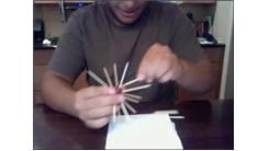 Most Toothpicks Stuck In A Grape In 30 Seconds