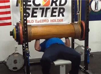 Most Reps Bench Pressing A 430-Pound Wooden Log