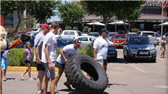 Fastest Time For Two People To Flip A 100-Kilogram Tire 2.5 Kilometers