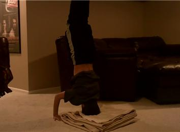fastest time to count to 50 while doing a headstand