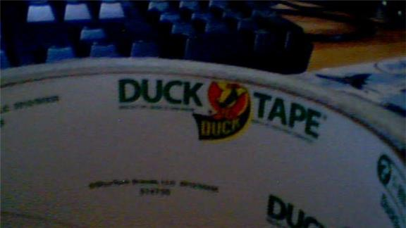 Most Dominoes Stacked on a Roll of Duct Tape