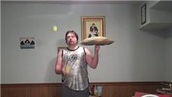 Longest Time To Spin A Pillow On One Finger While Juggling Two Tennis Balls