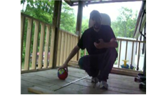 Most Left-Handed Behind-The-Back Shots Made Into A Little Tikes Basketball Hoop While Kneeling In One Minute
