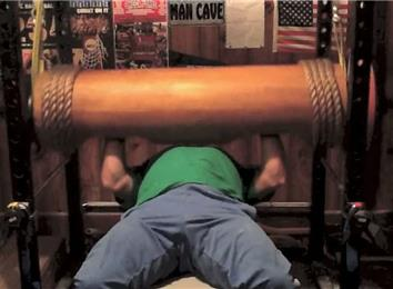 Most Reps Bench Pressing A 300-Pound Wooden Log