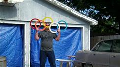 Longest Time Displaying The Olympic Rings With Five Juggling Rings Using Mouth And Hands While Balancing On A Rola Bola