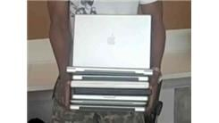 Most Apple Laptops Held At Once By A Professional Athlete