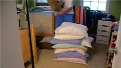 Highest Stack Of Pillows Sat On