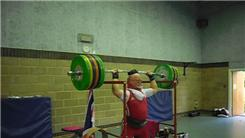 Heaviest Weight Balanced On Head With An Olympic Bar