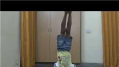 Fastest Time To Recite The Periodic Table While Doing A Headstand