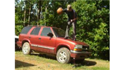 Most Basketball Dribbles In One Minute While Standing On The Hood Of An SUV In 30 Seconds