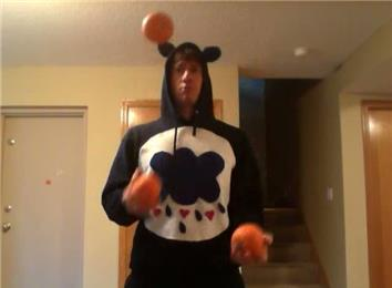 Longest Time Juggling Three Pumpkins In A Box Pattern While Dressed As A Care Bear