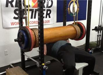 Most Reps Bench Pressing A 400-Pound Wooden Log